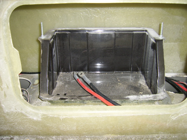Battery box and bespoke cabling visible through access panel in bulkhead