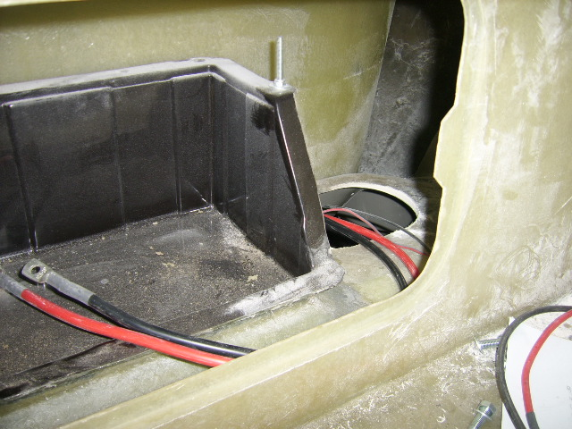 Battery box and fuel tank access hole