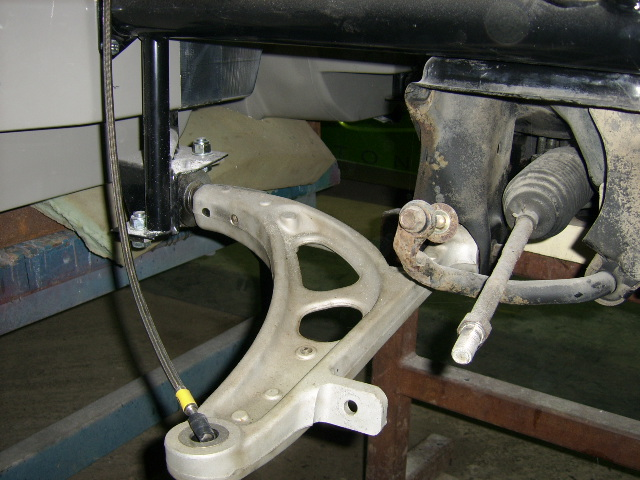 Alloy front wishbone and steering rack awaiting upright and calliper